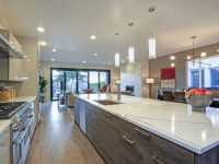 Open concept kitchen with a massive island fitted with quartz countertop.