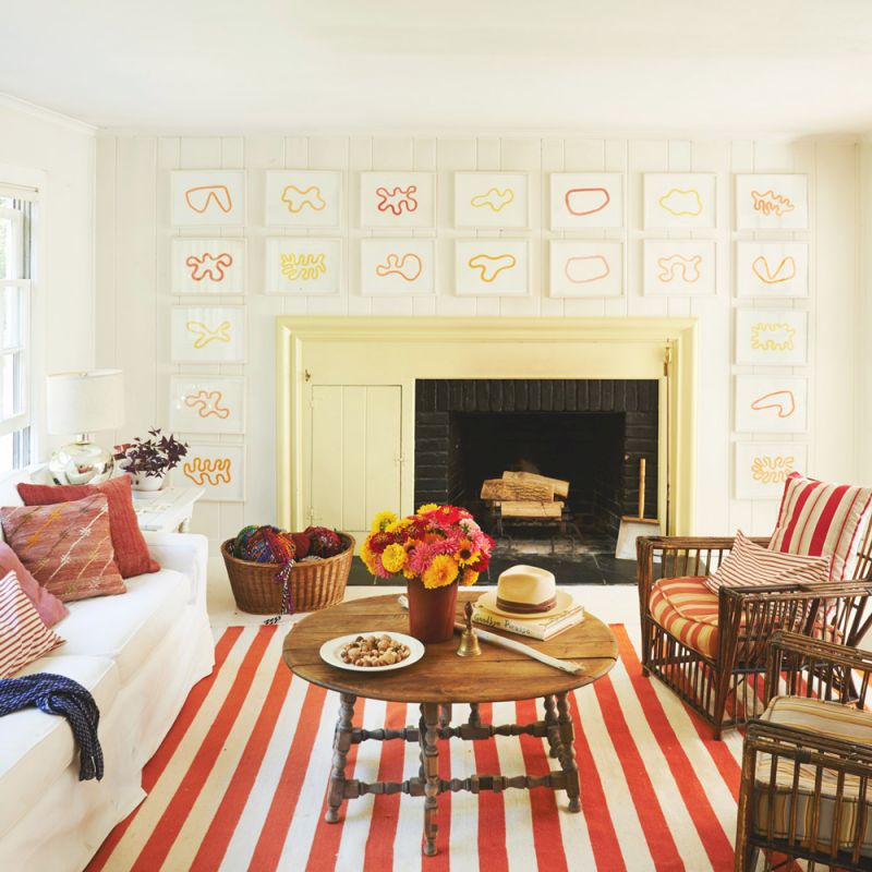 20 Ways To Decorate With Orange And Yellow - Coastal Living for Yellow Walls Living Room Interior Decor