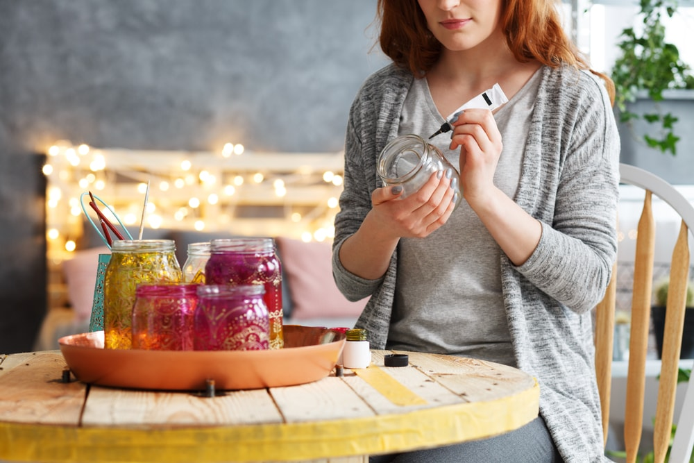 Woman working on DIY jars.