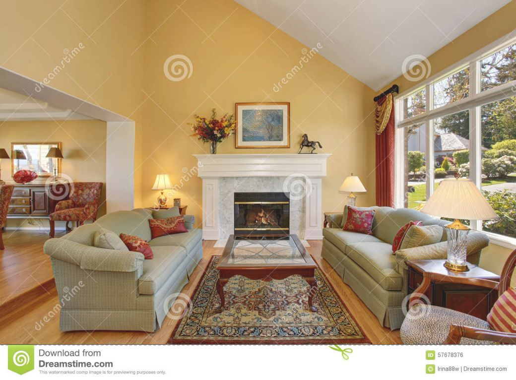 Brilliant Living Room With Green Sofas, And Yellow Walls with Yellow Walls Living Room Interior Decor
