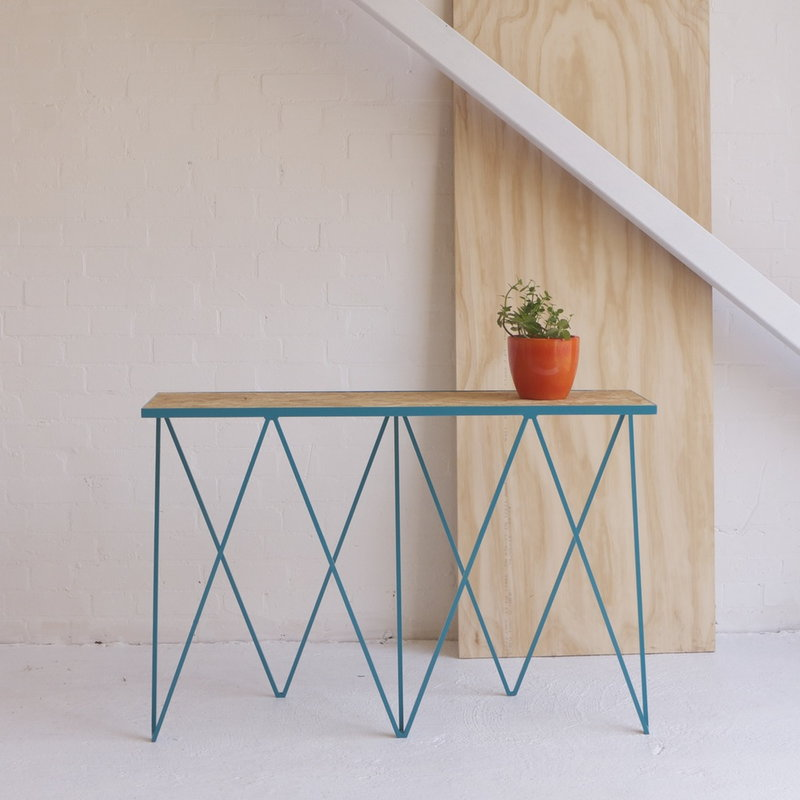 creative-designer-console-table-thin-zig-zag-legs-in-bright-turquoise-blue