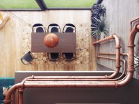 exposed-copper-pipes-in-industrial-dining-room