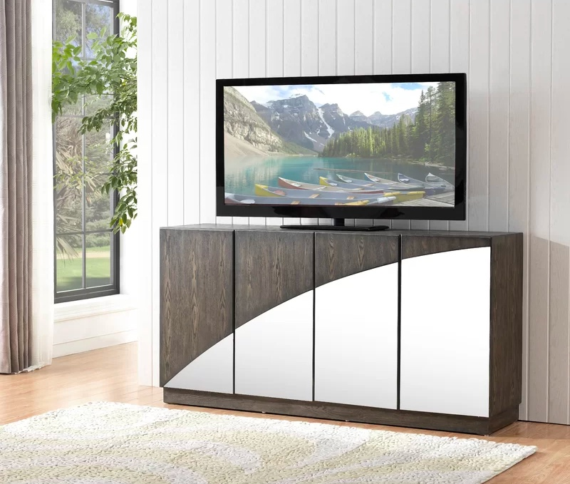 modern-TV-console-table-with-wood-cabinets-and-curved-mirror-accents