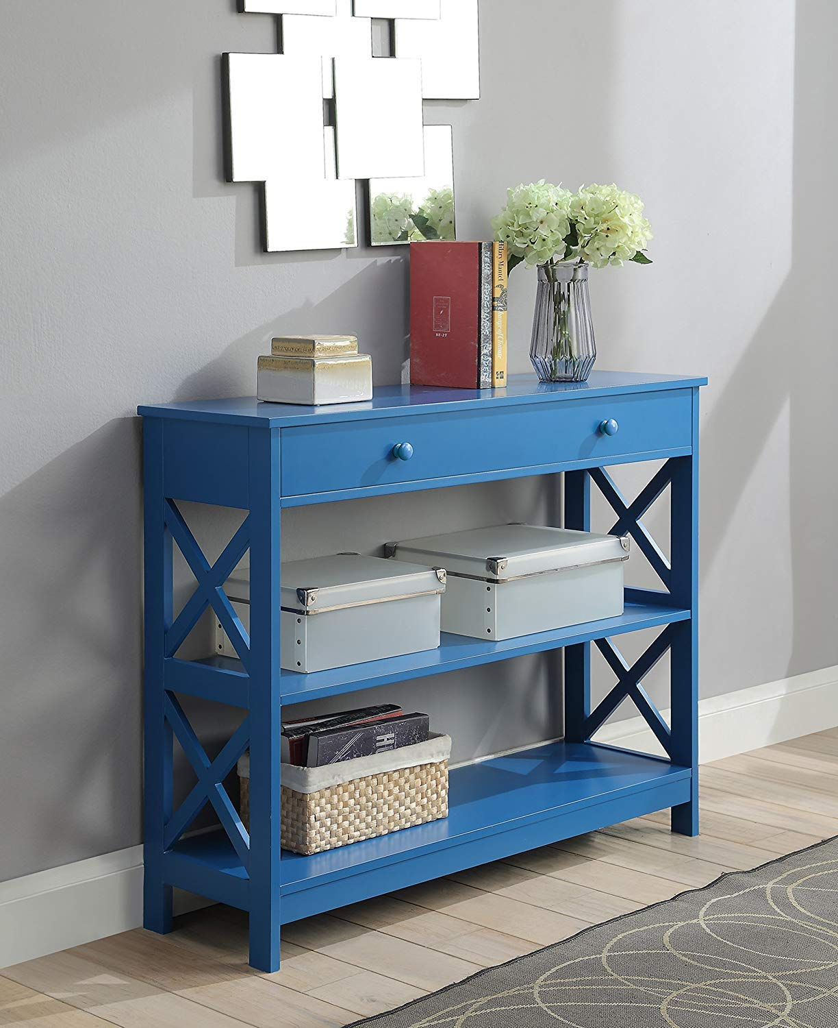 vibrant-blue-console-table-with-single-drawer-and-two-shelves-for-creative-entryway-interior-design