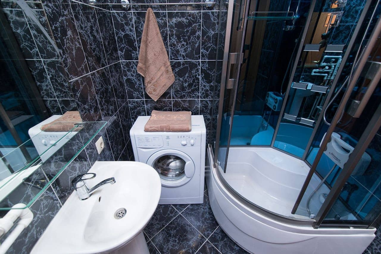 Top 15 Common Mistakes during Bathroom Renovations. Dark colored glossy tile