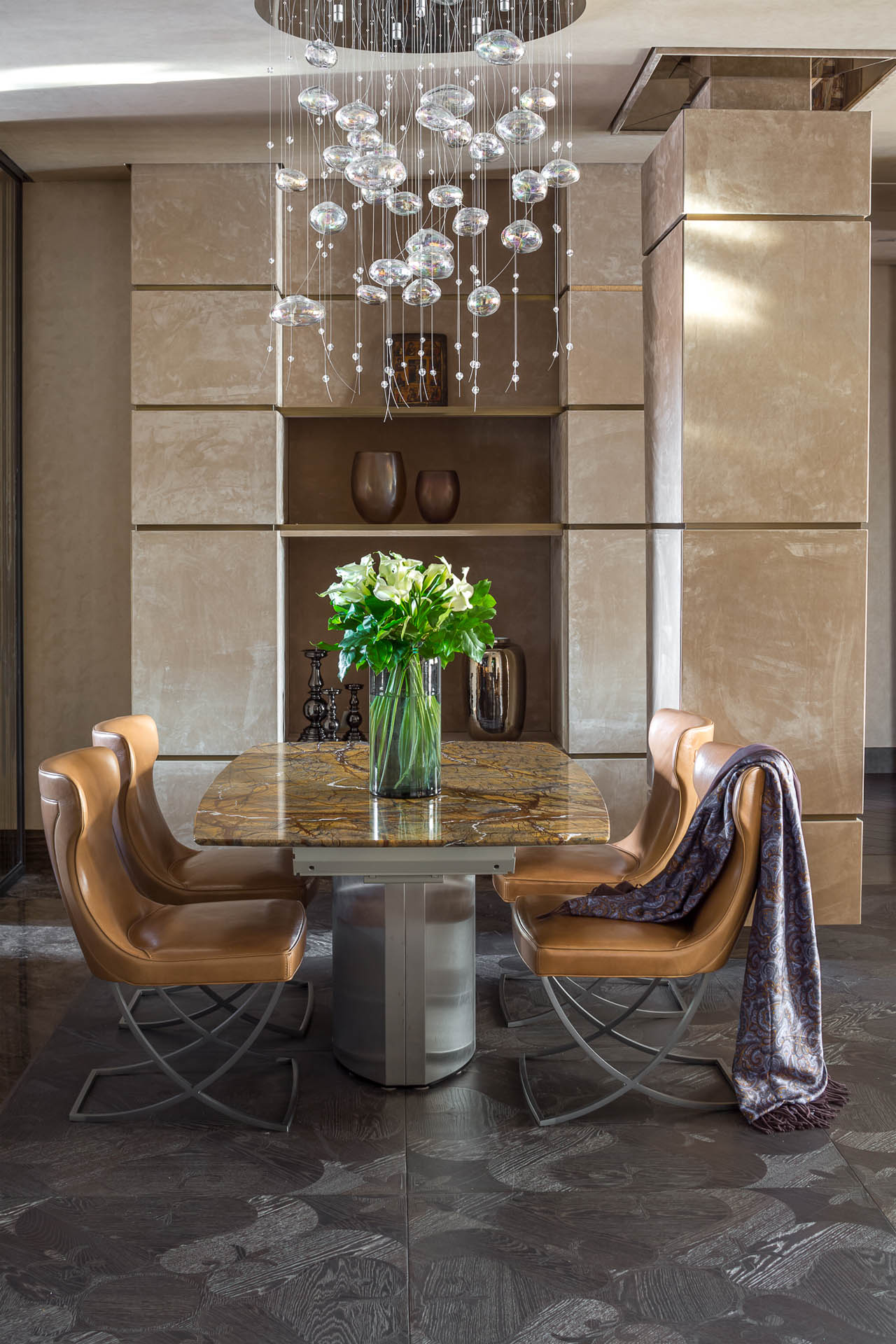 Brown leather dining chairs on scissor frame to finish the composition with marble top table