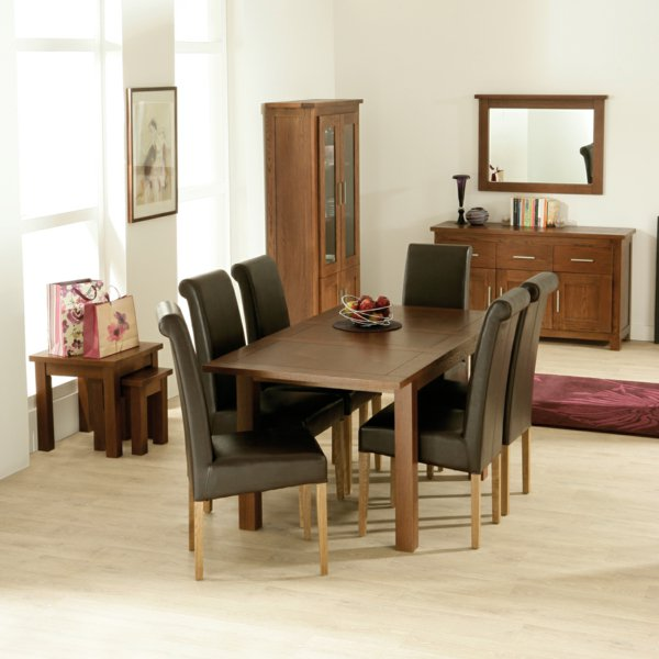 Chic wooden chair group at the brown table for classic room