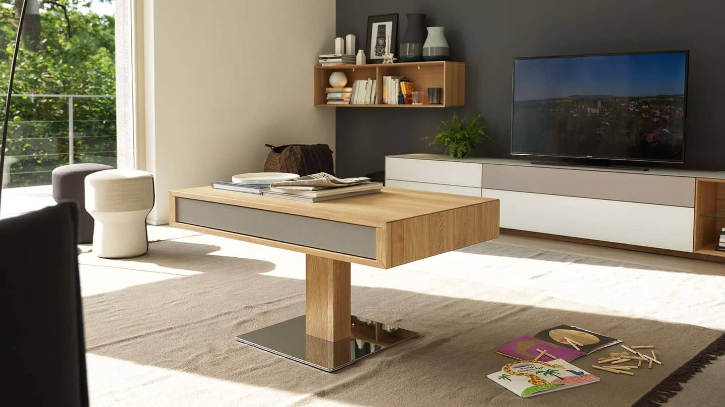 Great modern designed wooden adjustable desk as a coffee table