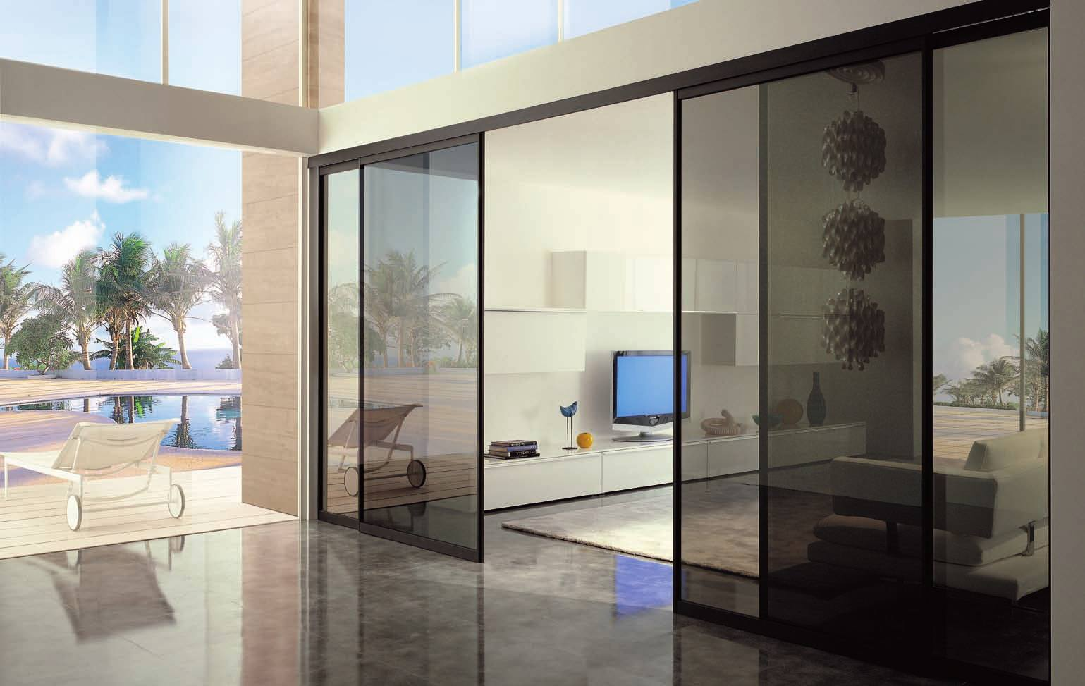 Toned glass doors as the entrance to the entertaining room