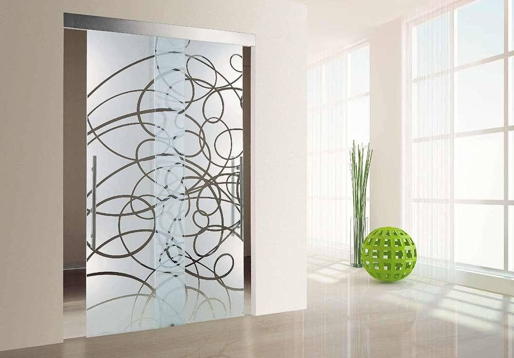 Peculiar lines on the glass door and green elements as the modern decoration for the light and spacious studio apartment