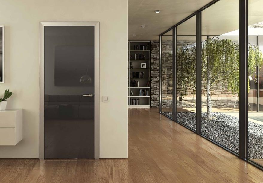 Laminated floor and dark semi-transparent interior glass door