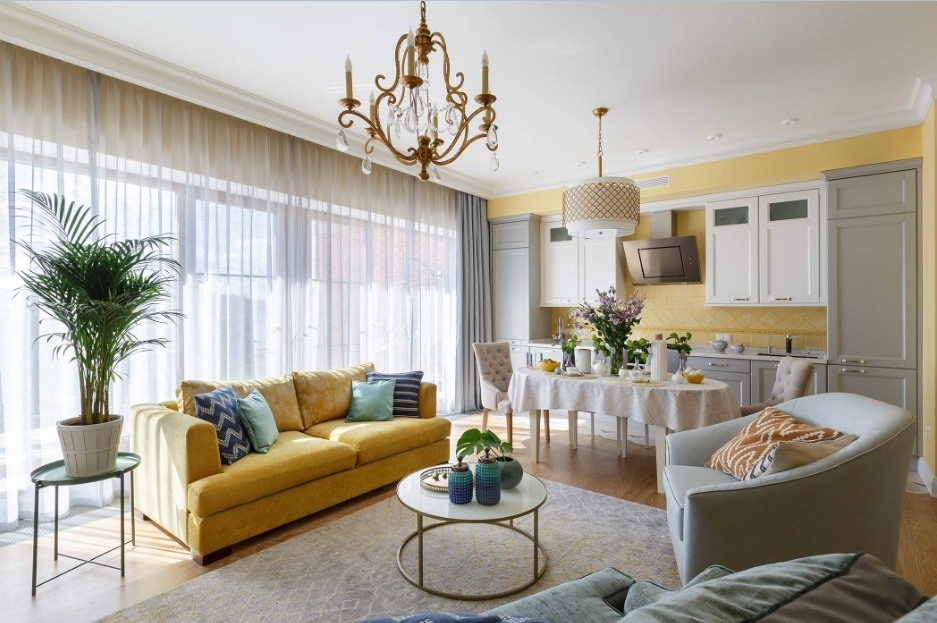 Unusual golden inlays in decoration of the Classic living room interior with huge tule-shaded windows