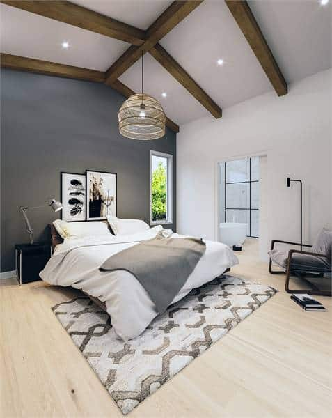 Master bedroom with beam cathedral ceiling, a gray accent wall, and an en-suite master bathroom. Source: TheHouseDesigners.com