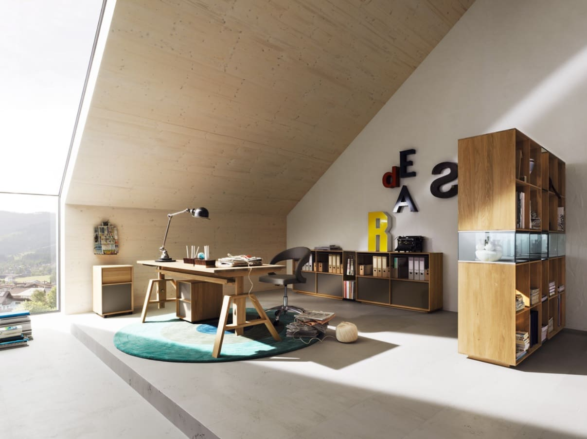 Adjustable Desk to Make Your Home Office more Universal. Mild warm color palette in loft room with wooden furniture