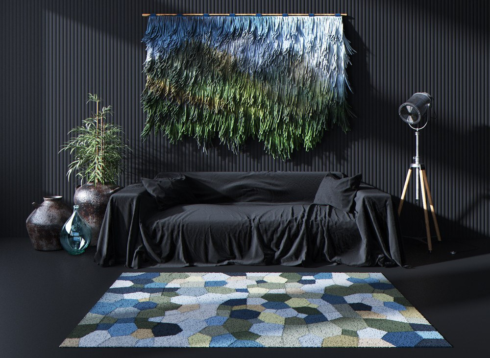 Dark colored bedroom with green and blue carpet at the headboard