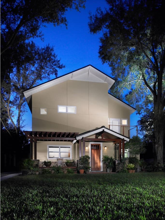 Gray panels to face the modern house with a porch deck and saltbox roof