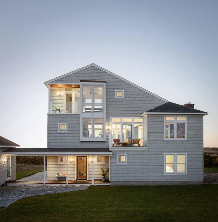 Gray wooden boards sheathing of the casual facaded house with saltbox roof