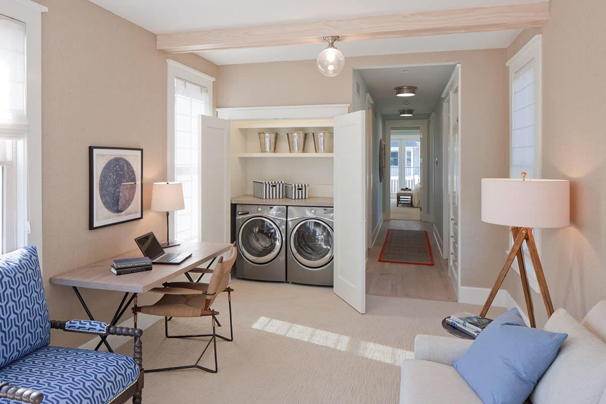 Laundry area across the family room and office. Next to it is the hallway leading to the master suite.