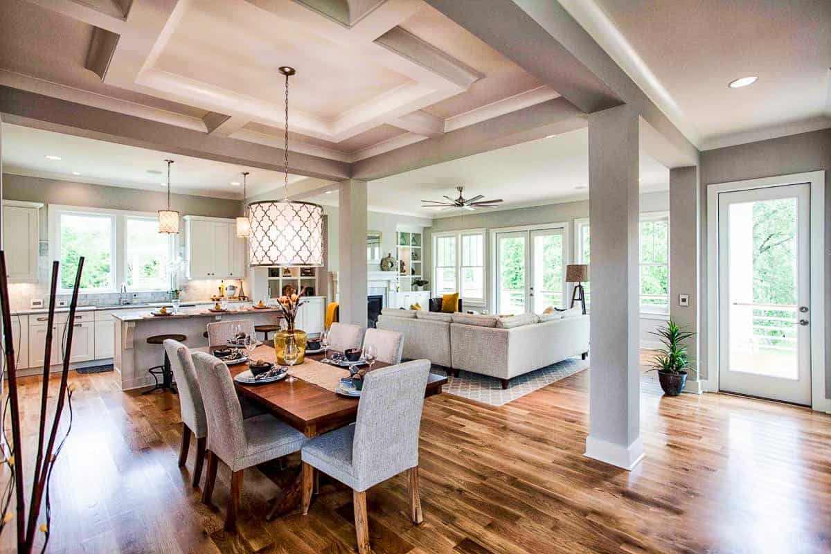 An open layout view shows the living room and eat-in kitchen with a stylish tray ceiling.