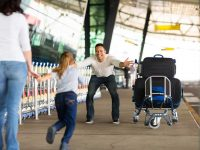 Young girl running to his father in the airport.
