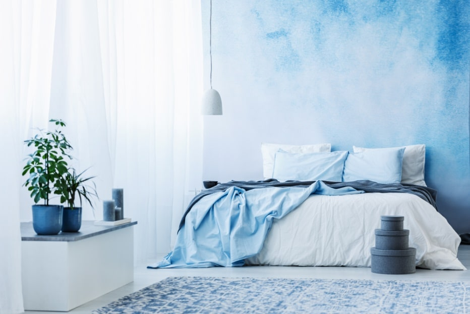 7 Simple Ways to Freshen Up Your Home This Spring. Cooling blue tones in very intimate bedroom