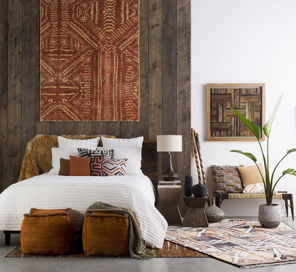 Simple interior design with the wood planked headboard and rug in the bedroom