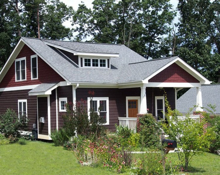 Another version of the bungalow home showcasing a deep red exterior siding.