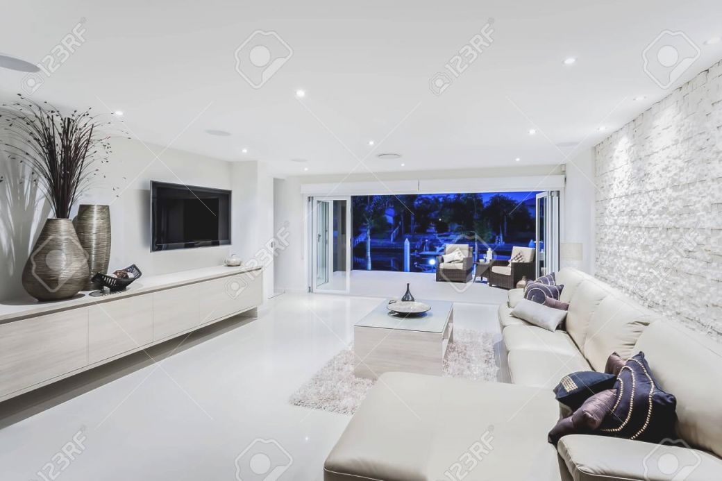 Modern Living Room At Night With Sofas And Pillows Next To Fancy.. with Decorative Items For Living Room