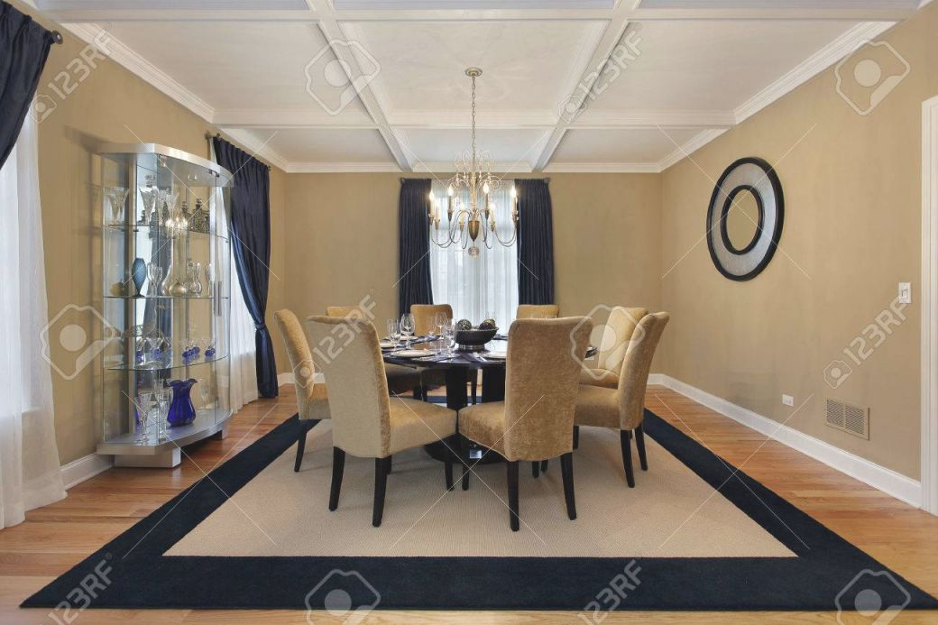 Dining Room With Tan Walls And Blue Drapes in Blue And Tan Living Room