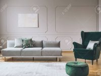 Elegant Living Room Interior With Emerald Green Chair With Pillow.. regarding Chairs For Living Room Cheap