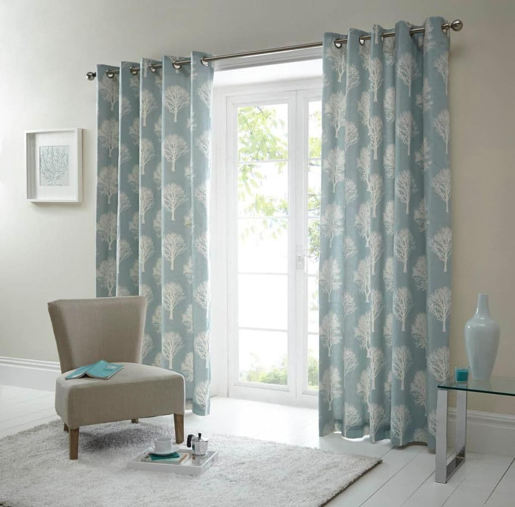 Colorful drapes for monochromatic gray living room
