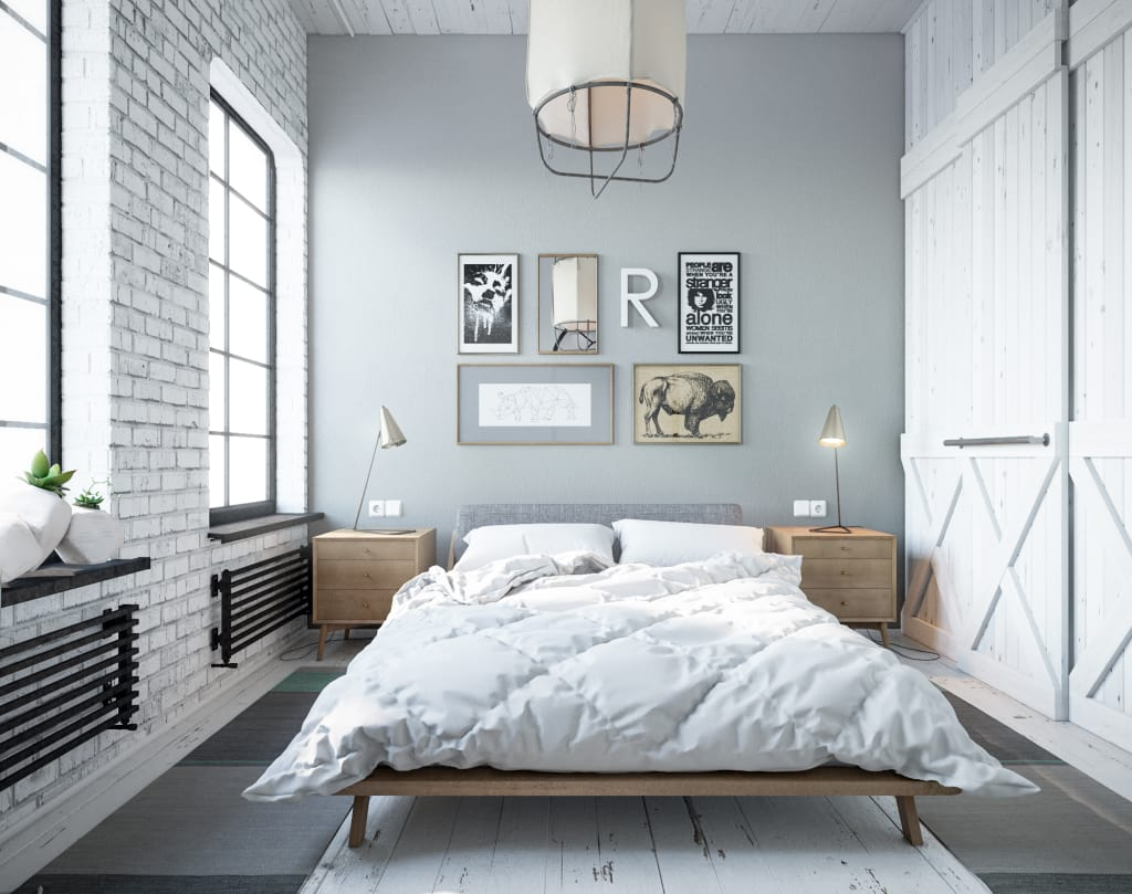 Simple decorated bedroom with gray walls and whitewashed brickwork accent