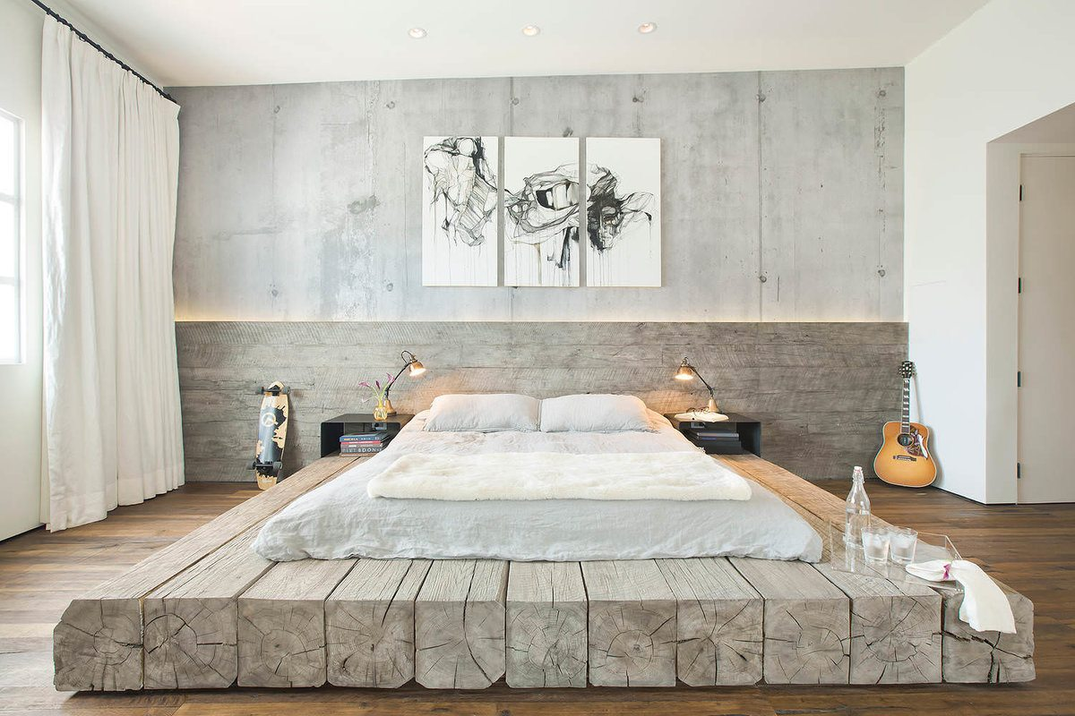 Log set large bed platform and faux concrete painted walls in the urbanistic bedroom