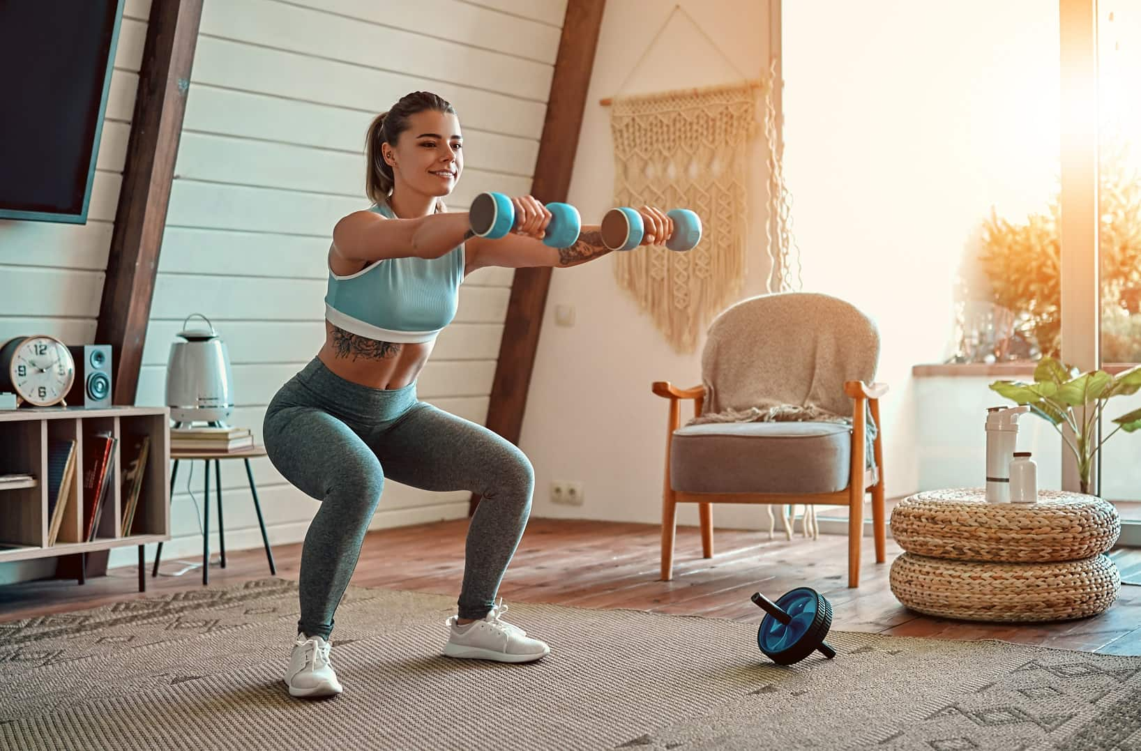 4 Tips to Create a Home Gym Out of a Small Space. A pair of cumbbells and an abdominal wheel can turn any room into small workout area