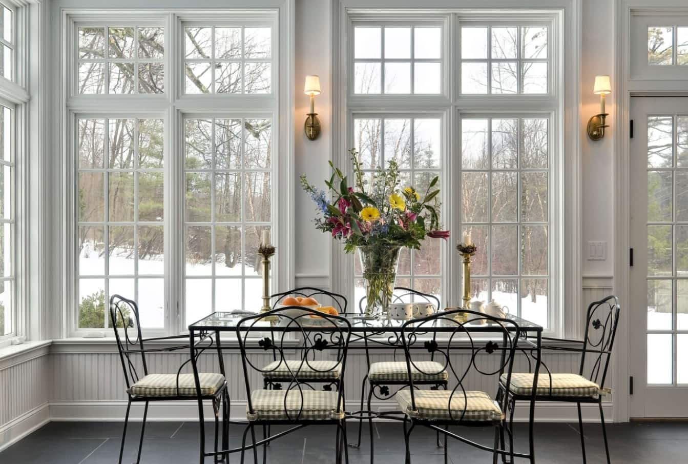 10 Ways to Stay Warm in Your Home without a Furnace. Nice spacious living Large sash window for white classic interior