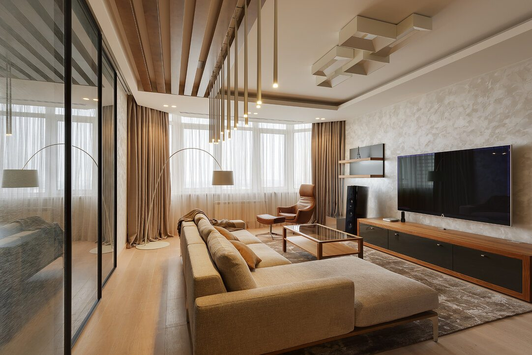Minimalism for Living Room: Laconic Practical Design. Classic touch and modern appliances for gold and beige colored room