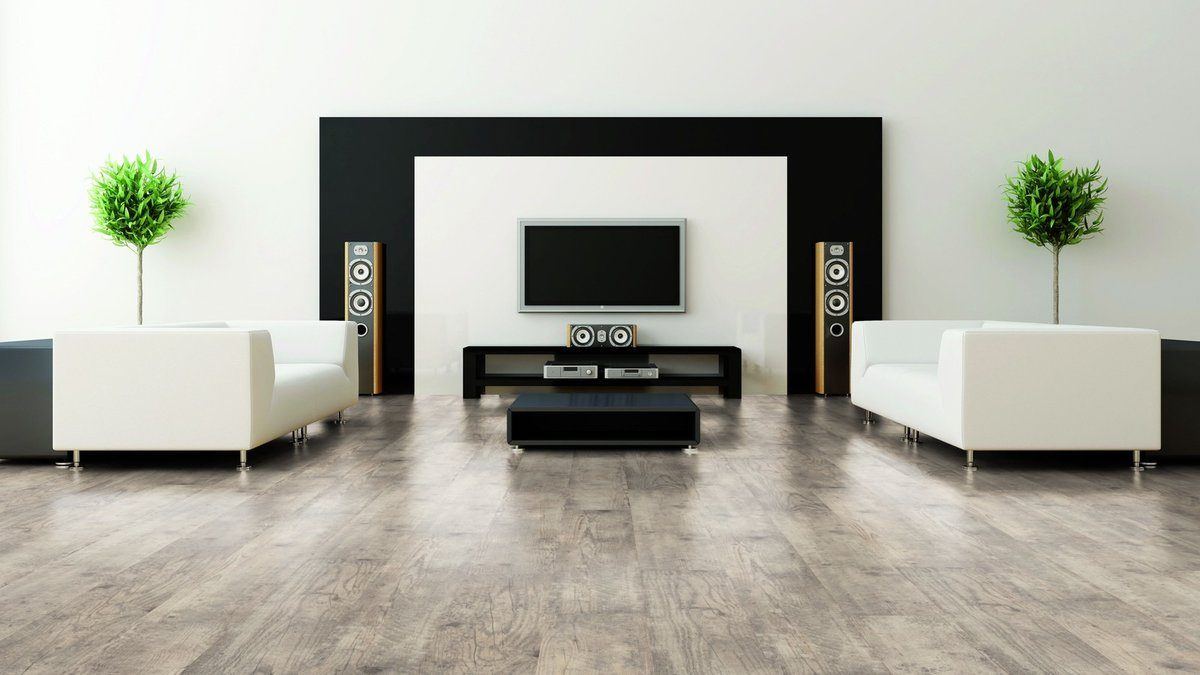 Bright example of minimalism in the living room with black accent on the wall with sound system and TV