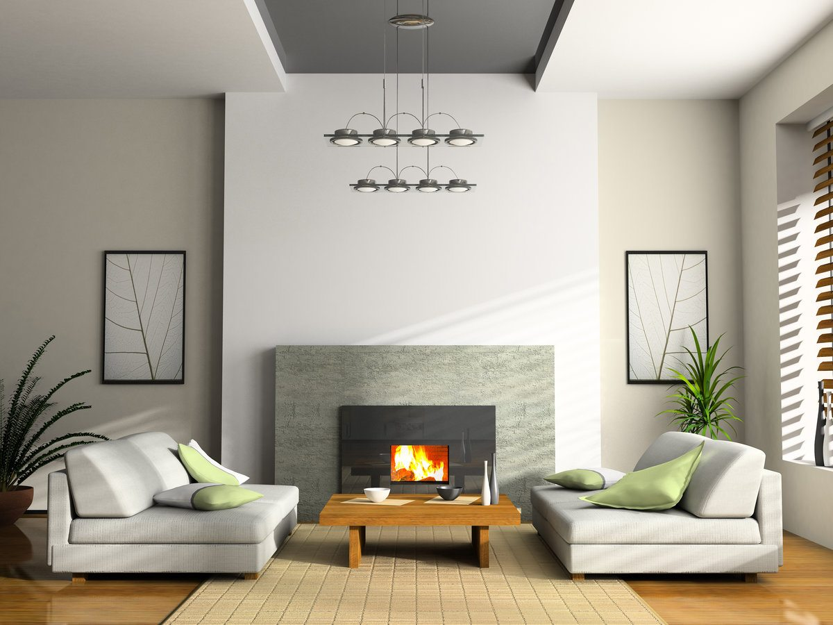 White accent wall with cladded artificial fireplace and low coffee table in front