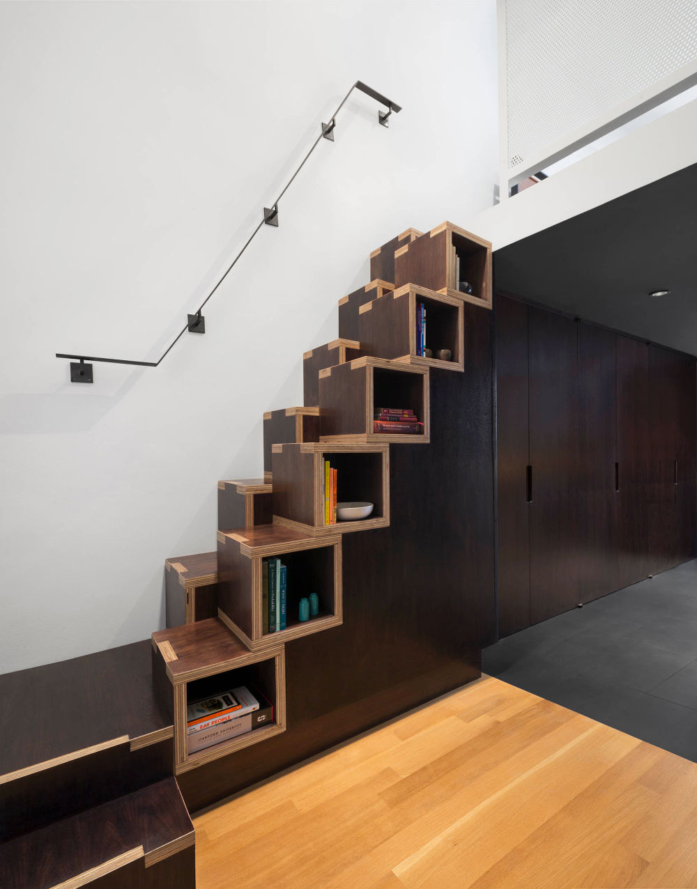 black-and-wooden-library-stair-step-bookcase
