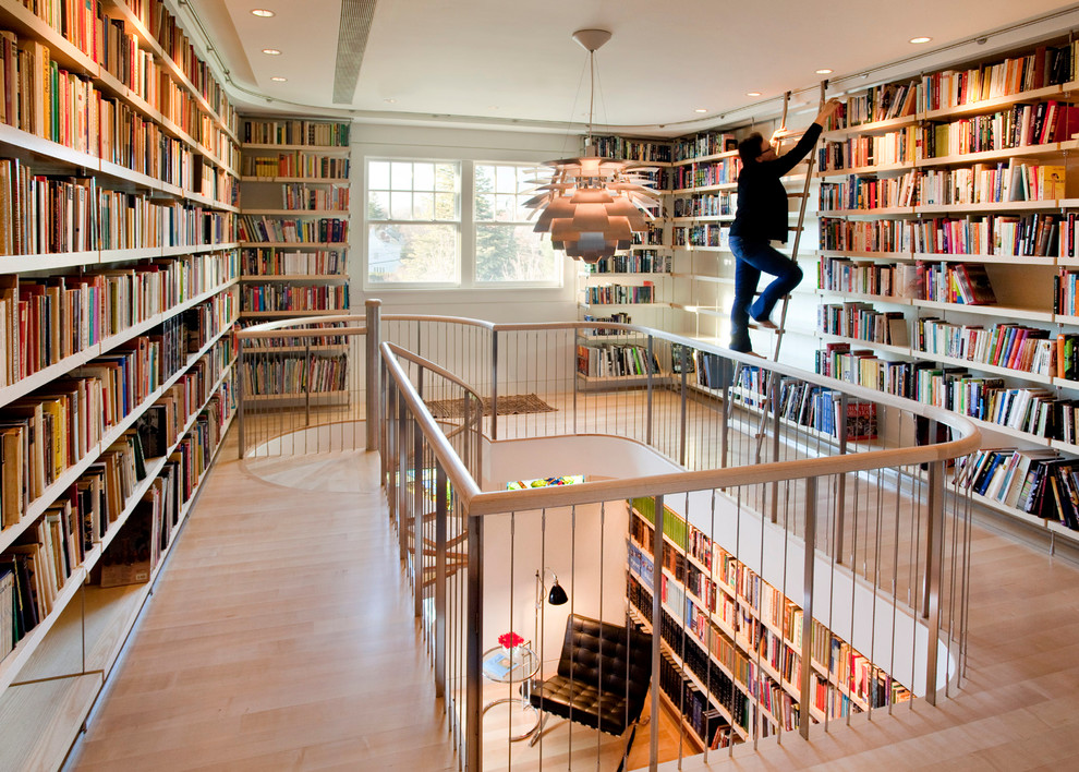 gated-stairwell-walls-lined-with-bookcases-stair-step-bookcase