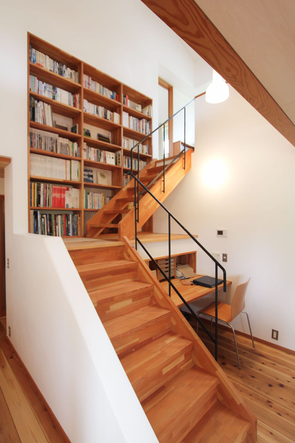library-wall-in-middle-of-stair-step-bookcase