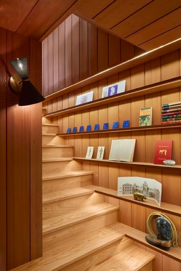 lit-wooden-library-panel-under-stairs-shelving