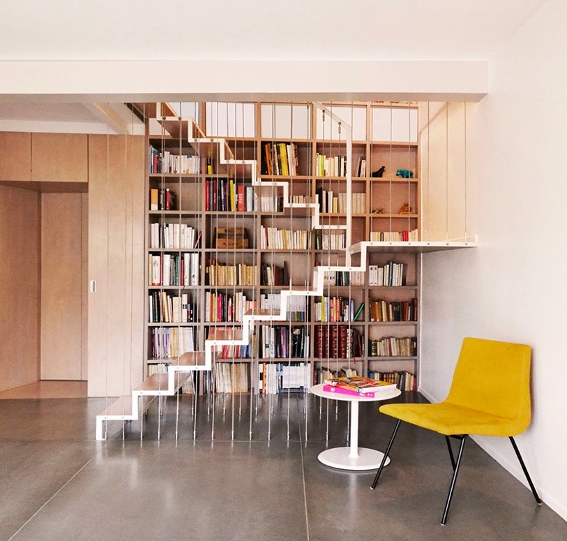 white-metal-winding-under-stairs-bookcase