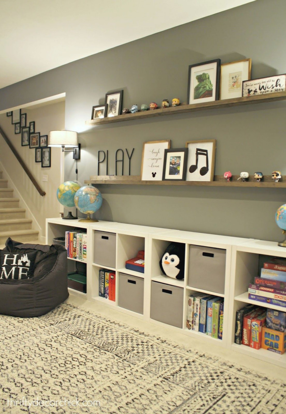 Huge Empty Wall Transformed Into Pretty Game And Toy Storage intended for 8+ Amazing Inspiration Ideas For Toy Storage Ideas Living Room