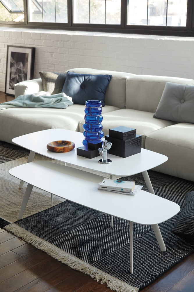 contemporary-white-coffee-table-surfboard-shaped-tabletop-minimalistic-design-tapered-slanted-legs-designer-living-room-furniture