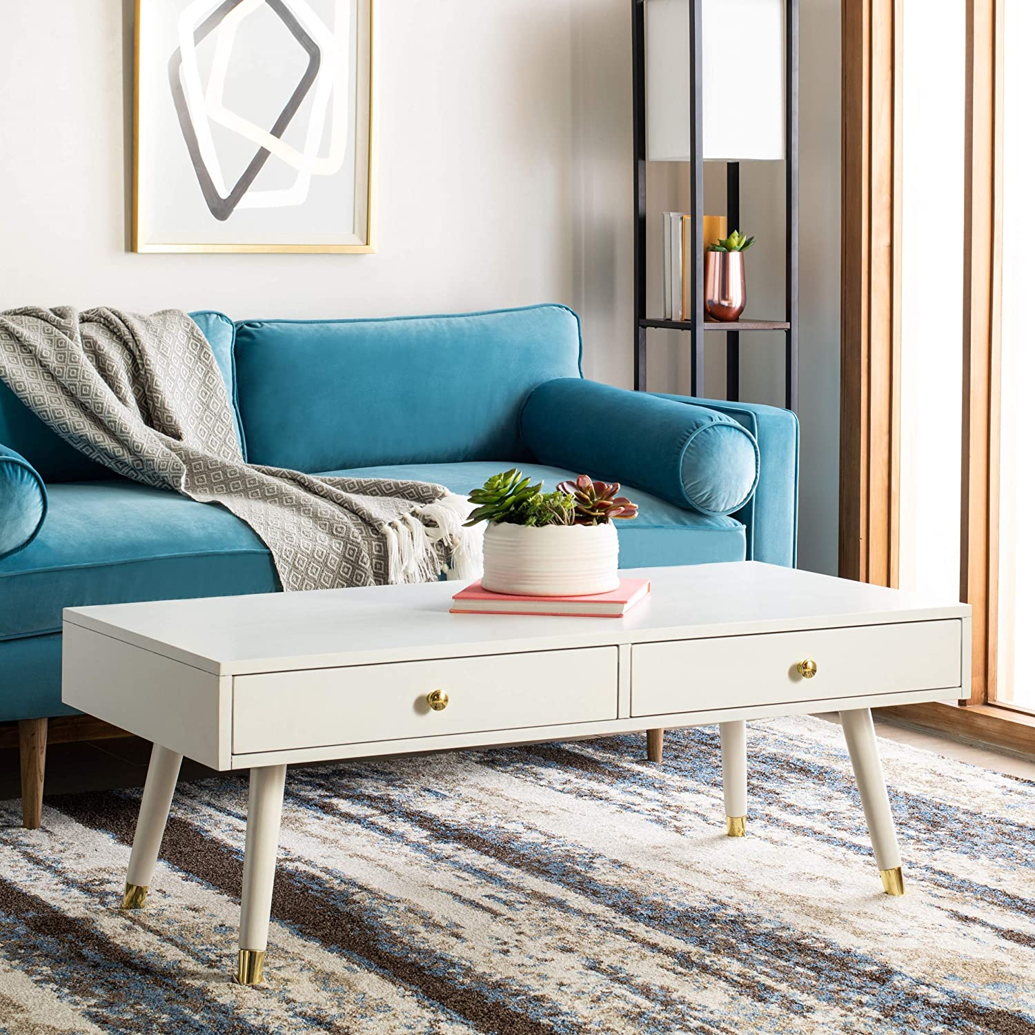 cute-mid-century-modern-white-coffee-table-with-drawers-gold-hardware-tapered-dowel-legs-with-metal-caps