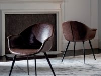 dark-faux-leather-upholstered-dining-chairs-rounded-backrest-armrests-comfortable-sophisticated-furniture-for-vintage-dining-room-style