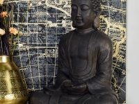large-buddha-statue-for-spiritual-home-interior-inspiring-polystone-sculpture-dark-black-finish-modern-meditation-corner-ideas
