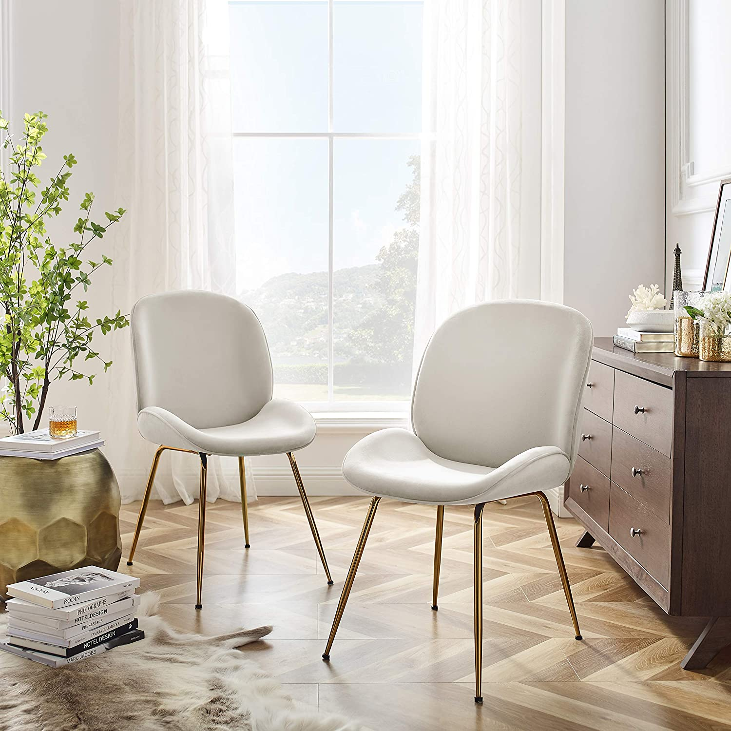 light-white-beige-upholstered-dining-chairs-shell-chair-shape-ergonomic-stylish-dining-chairs-luxury-gold-legs-sophisticated-dining-room-ideas