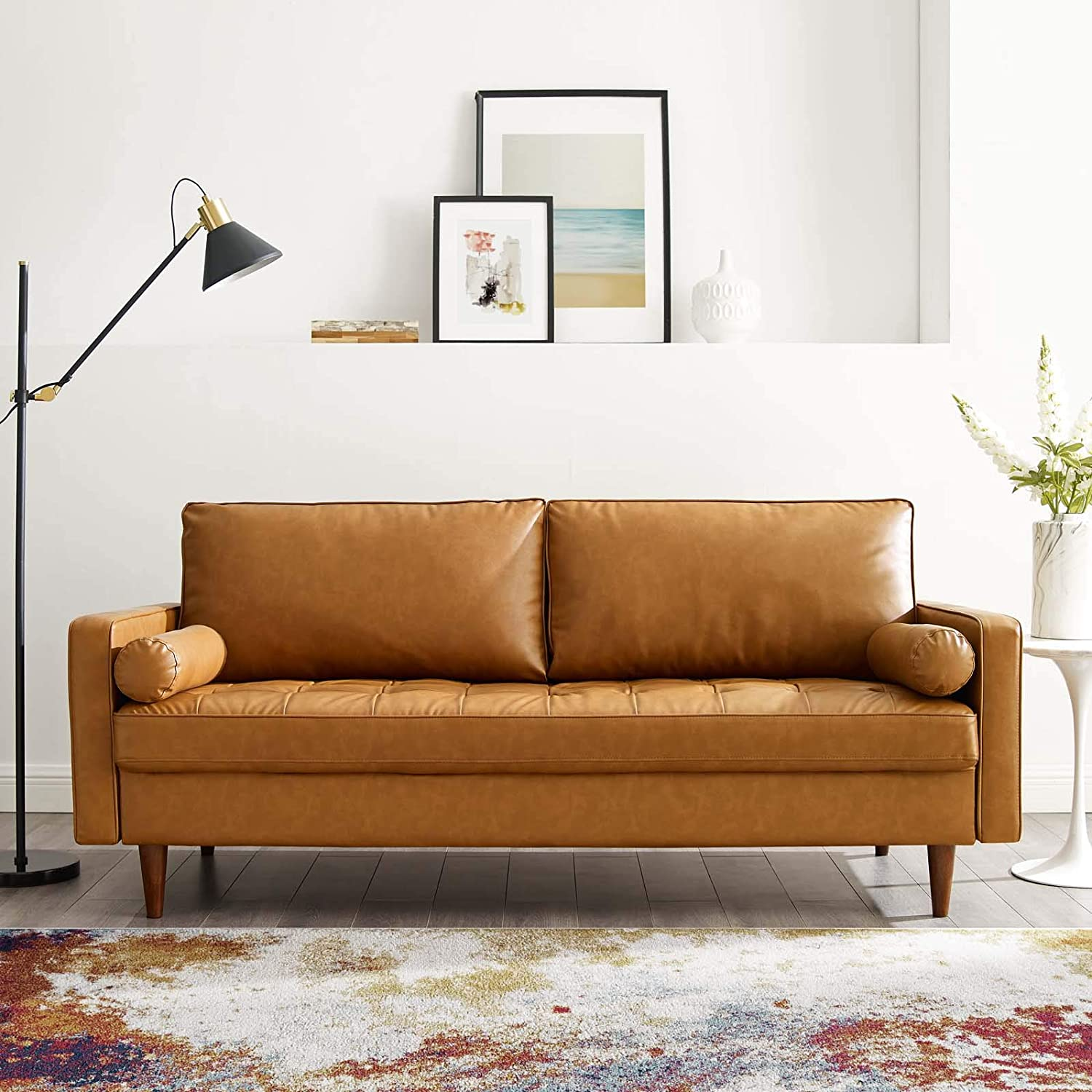 mid-century-modern-small-sofa-for-bedrooms-vegan-leather-upholstery-camel-color-side-bolster-pillows-tapered-legs